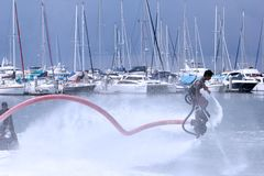 Unidentfied man demonstrates flyboard acrobatics, Royalty Free Stock Images