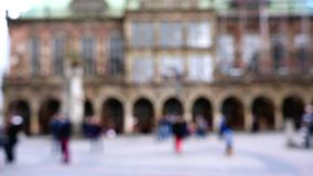 Unidentifiable people walking on market square in from of main hall in Bremen, Germany. stock footage