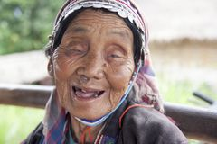 Unidentified Akha tribe. Elderly woman with traditional clothes and silver jewelery in hill tribe minority village, Thailand stock image