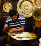 Unidentified Arabic people make traditional metal plate in a mar Royalty Free Stock Image