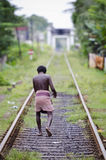 Unidentified asian man on railway lines. Royalty Free Stock Images