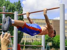 Unidentified athlete performs during the street workout champion Royalty Free Stock Photos