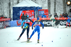 Unidentified athletes at the finish line in the FIS Cross-Country  World Cup Stock Photography