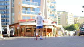 An unidentified athletic man practicing Nordic walking early in the morning. stock footage