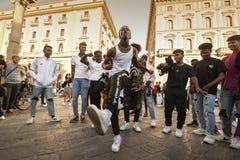 Unidentified B-boy break dancers perform in the street for the crowd. Hip Hop battle at a informal street dance meet