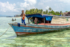 Unidentified Bajau family of three generations living in a boat. Royalty Free Stock Photography