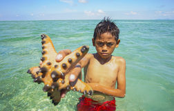 Unidentified Bajau Laut kids on a boat in Maiga Island Royalty Free Stock Photos