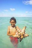 Unidentified Bajau Laut kids on a boat in Maiga Island Stock Image