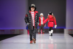 Unidentified beautiful child models walk catwalk. MOSCOW - FEBRUARY 22: Unidentified beautiful child models wear fashions from Snowimage and walk the catwalk in Royalty Free Stock Images
