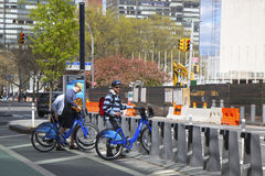 Unidentified bike rider renting Citi bike in Manhattan Stock Photos