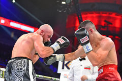 An unidentified boxers in the ring during fight for ranking points. Gdansk, Poland -September 17, 2016: An unidentified boxers in the ring during fight for Stock Image