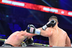 An unidentified boxers in the ring during fight for ranking points. Gdansk, Poland -September 17, 2016: An unidentified boxers in the ring during fight for Royalty Free Stock Photo
