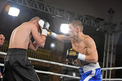 An unidentified boxers in the ring during fight for ranking points Stock Photos