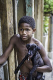 Unidentified boy wit a dog in Favela (slums) in Rio de Janeiro. Stock Photography
