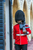 Unidentified  British Queen's Guard marching on duty inside Windsor Castle Stock Photos