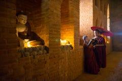 Unidentified Buddhism neophyte prays in Buddihist temple Royalty Free Stock Photo