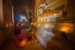 Unidentified Buddhism neophyte prays in Buddihist temple Stock Photos