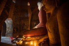 Unidentified Buddhism neophyte prays in Buddihist temple Stock Image