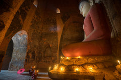 Unidentified Buddhism neophyte prays in Buddihist temple Stock Images