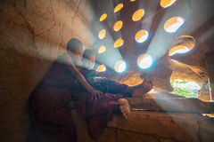 Unidentified Buddhism neophyte prays in Buddihist temple. Royalty Free Stock Image