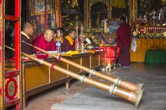 Unidentified Buddhist lama play music near stupa Boudhanath. Stupa is one of the largest in the world Stock Photos