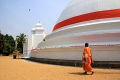 Unidentified Buddhist monks do prayers at the Kelaniya Raja Maha Vihara in Colombo, Sri Lanka. Royalty Free Stock Photography