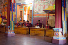 Unidentified buddhist monks are praying Royalty Free Stock Image