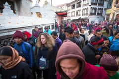 Unidentified Buddhist pilgrims near stupa Boudhanath during festive solemn Puja Stock Photos