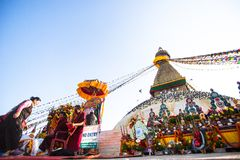 Unidentified Buddhist pilgrims near stupa Boudhanath during festive solemn Puja Royalty Free Stock Photo