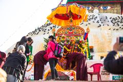 Unidentified Buddhist pilgrims near stupa Boudhanath during festive solemn Puja Royalty Free Stock Photography
