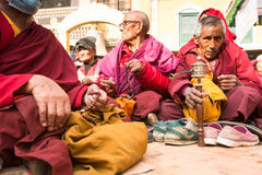 Unidentified Buddhist pilgrims near stupa Boudhanath during festive solemn Puja Stock Photography