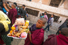 Unidentified Buddhist pilgrims near stupa Boudhanath during festive solemn Puja Stock Images