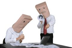 Unidentified businessman scolding his worker on studio. Image of unidentified businessman scolding his worker with a megaphone,  on white background Stock Image