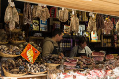 The unidentified butchers  at Christmas market in Paris. Paris; France-November 22; 2015: The unidentified butchers  selling Corsica's  delicatessen at Royalty Free Stock Photo