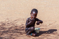Unidentified child Himba tribe in Namibia Royalty Free Stock Photo