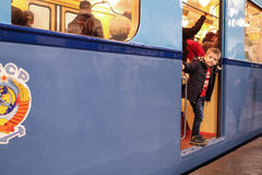 Unidentified child looks vintage subway car Royalty Free Stock Photography