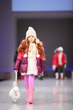 Unidentified child model walk the catwalk Stock Images