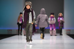 Unidentified child models walk the catwalk. MOSCOW - FEBRUARY 22: Unidentified beautiful child models wear fashions by Snowimage and walk the catwalk in the Royalty Free Stock Images