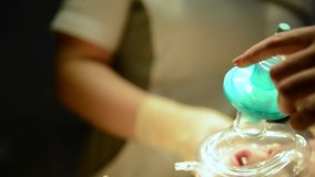 Child with an oxygen mask on critical surgery. Unidentified Child with an oxygen mask on a critical surgery stock footage