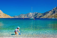 Unidentified child playing at sea bay, Greece Stock Photo