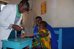 An unidentified child is subjected to HIV tests in the dispensary of the village Pomerini-Tanzania-Africa. August 12, 2014-Pomerini-Tanzania-Africa-An royalty free stock image