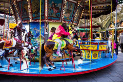 Unidentified children on Christmas market carousel in  Baden-Baden, Germany Royalty Free Stock Images