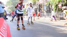 Unidentified children of Kolkata city rollerskating on blocked road, India stock video