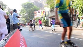 Unidentified children of Kolkata city rollerskating on blocked road, India stock video footage