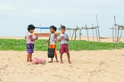 Unidentified children talking in natural landscape on sand beach near a village. NEGOMBO, SRI LANKA - DEC 21, 2017: Unidentified children talking in natural Stock Images