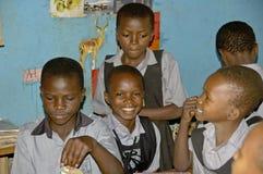 Unidentified children in township school near Kampala. Stock Photos