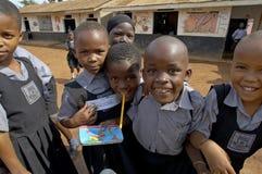 Unidentified children in township school near Kampala. Royalty Free Stock Photo