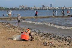 Chowpatty beach rubbish cleaner Mumbai India royalty free stock photos