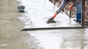Unidentified Construction workers make shape concrete road. Road work, street repair stock video