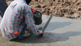 Unidentified Construction workers make shape concrete road. Road work, street repair stock video footage